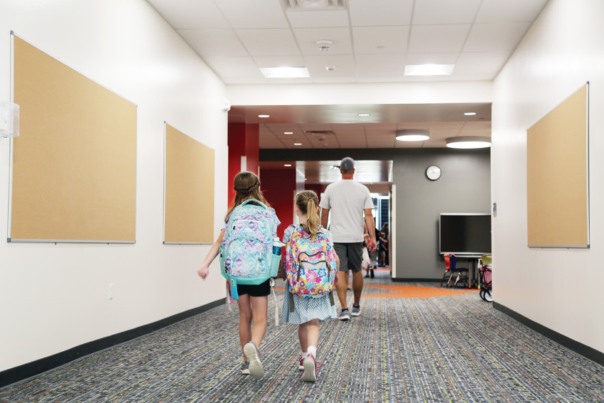 Students walk to class together on the first day of the new school year at Sierra Elementary Aug. 16.
