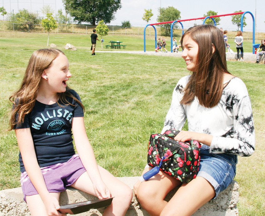 Friends Gwyneth Nelson, left, and Macy Dale, both seventh-graders at Bell Middle School, share a laugh during lunch on Aug. 16, the first day of school. Although the two went to different elementary schools last year, they became friends about a year ago because of their involvement in other parts of the Golden community.