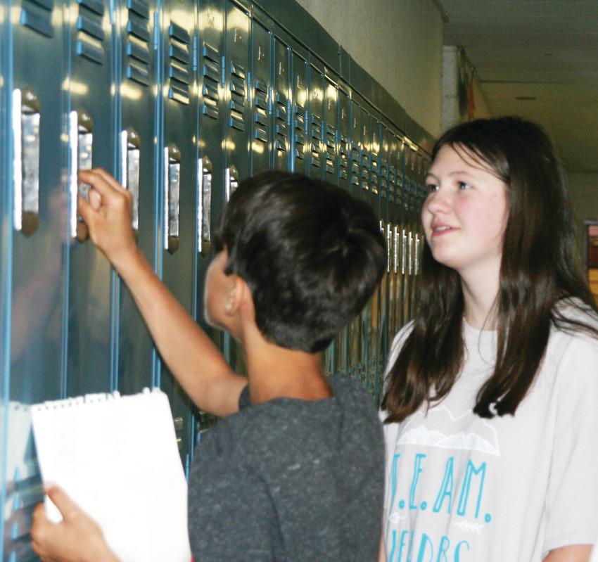 Getting a locker for the first time is one of the most exciting, yet sometimes complicated, aspects of entering middle school. Emma Wengrovius, an eighth-grade TEAM leader at Bell Middle School, assists sixth-grader Halim Carr with his new locker on Aug. 16.