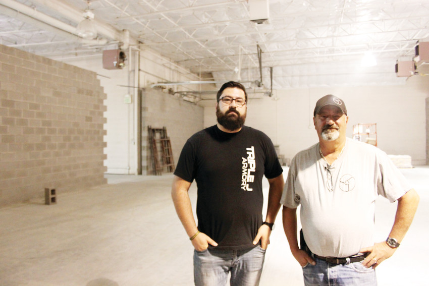 Triple J Armory owners JD Murphree, left, and his dad Dennis Murphree stand in their as-yet-unfinished shooting range in the SouthPark neighborhood. Neighbor concerns, city action and a lawsuit have muddied the waters around the Murphrrees' plans.