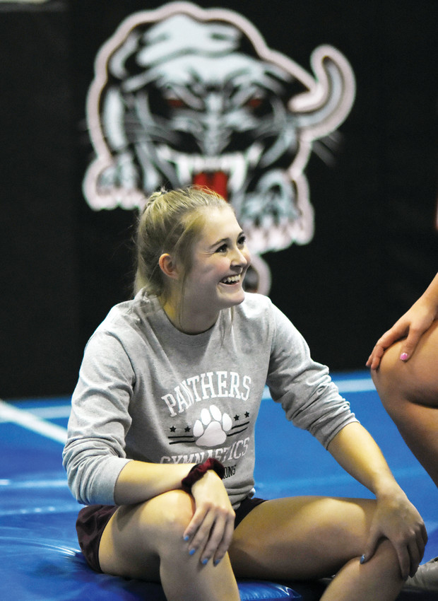 Pomona gymnast Kaylie Berens, a junior at Wheat Ridge High School, is all smiles during practice last week. Berens is the returning Class 5A all-around individual state champion.