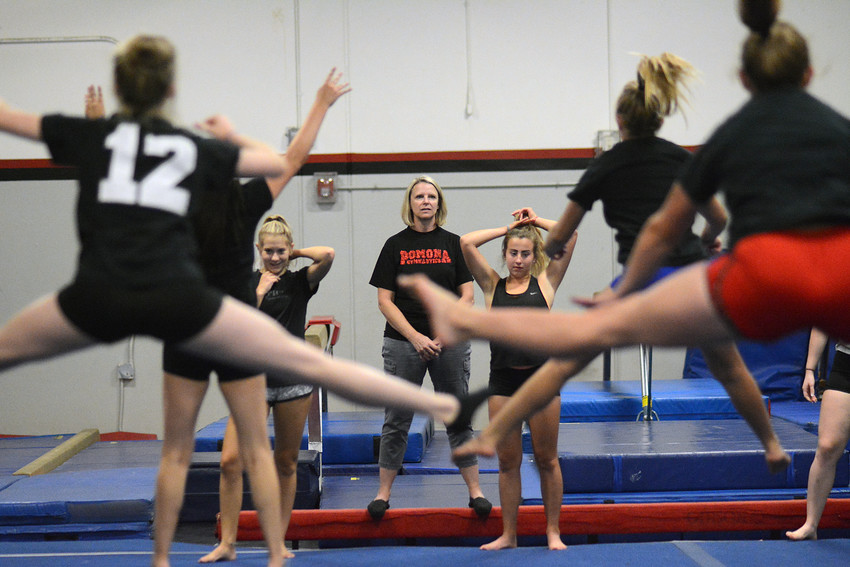 Pomona's gymnastics team at work at the start of the 2017 season.