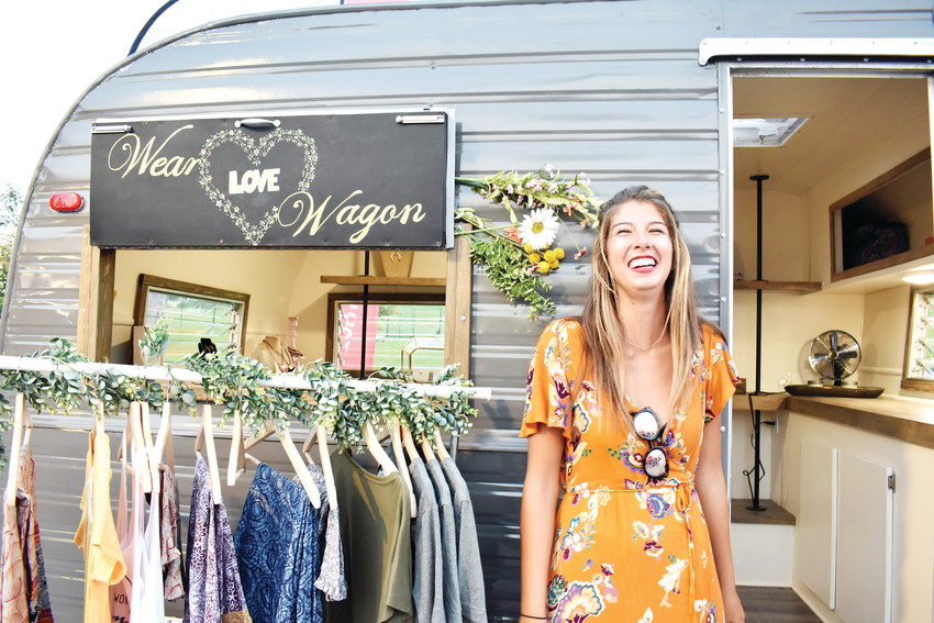 Wear Love Wagon founder Ashlee Nawrocki poses outside of her mobile boutique.