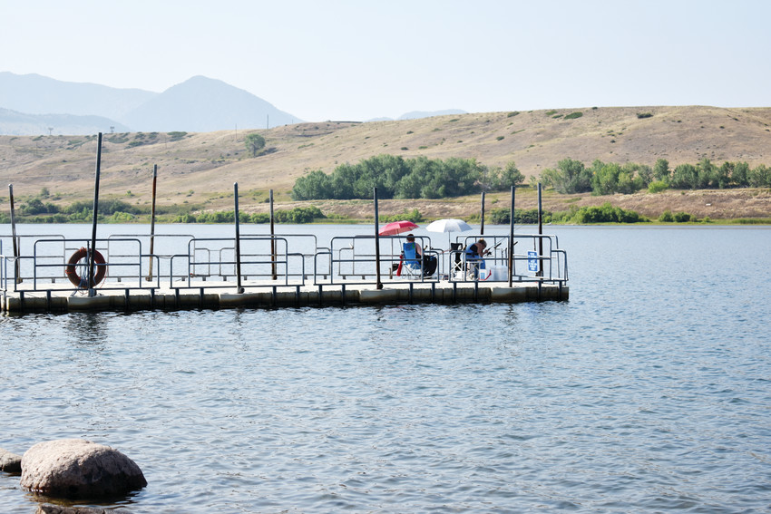 Deanna Fine and her daughter Jennifer Devine fish off of one of the piers at the Arvada Reservoir.