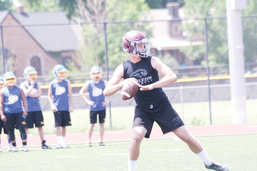 Quarterback Matt Francis prepares to throw a pass to a Horizon teammate during the Bronco 7-on-7 tournament this summer at All City Stadium in Denver. Francis is one of 16 seniors returning to Horizon's lineup this fall.
