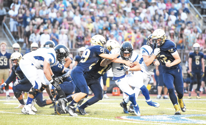 Legacy High School hopes to build on last year's 6-4 season with a new coach and some talent. Here, Legacy linebackers Nick Jensen (29) and Adam Lynch (15) help stop Grandview running back Bradley Shafer early in the first quarter of a 2017 game.
