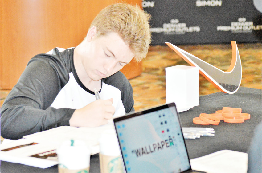 Callan Willey, 16, of Erie, fills at an application Aug. 17 to work at the Nike Outlet and the soon-to-be opened Denver Premium Outlet Mall. The Prospect Ridge Academy Junior said he came to a job fair at the Westin Hotel Westminster just to apply to work at the new store, due to open Sept. 27.