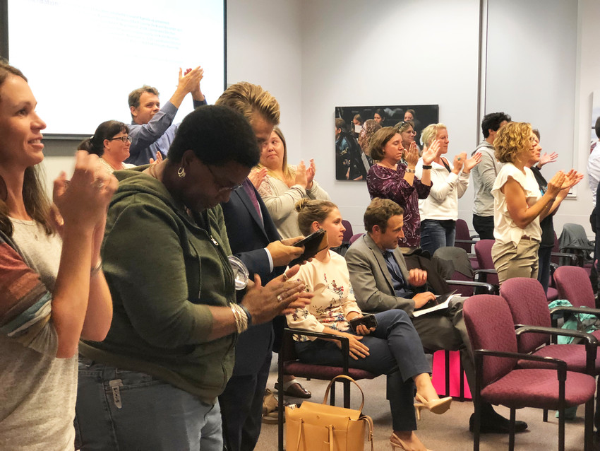 Community members give a standing ovation to the Douglas County Board of Education after six of the seven members voted unanimously to approve a tax measure for the November ballot. The decision happened at an Aug. 21 board meeting in Castle Rock.