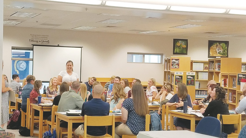 Elizabeth School District welcomed 30 new teachers, including Tiffany Khoury, shown standing.