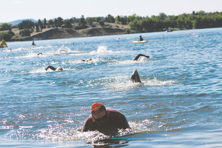 Swimmers come to shore after finishing a 5K swim in Chatfield Reservoir for the inaugural Denver Open Water Swim for Swim Across America. The event raised almost $200,000 for cancer research.