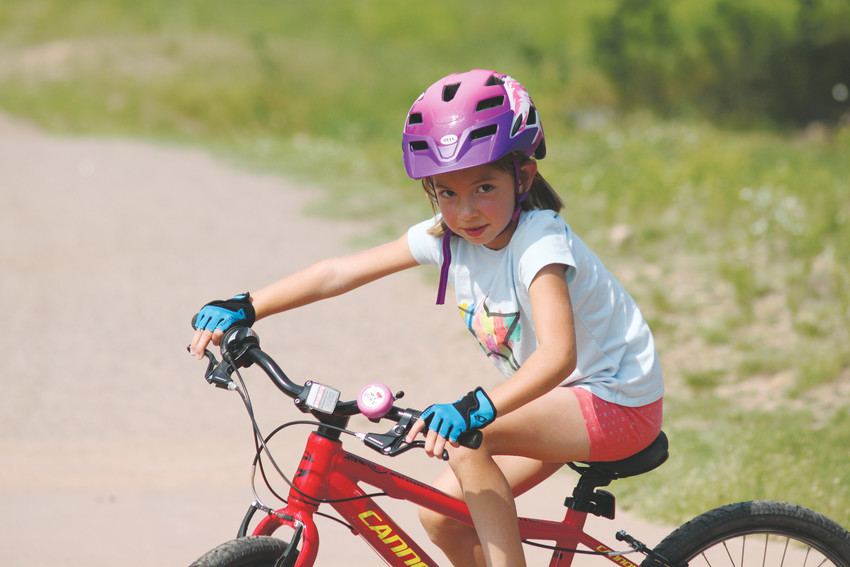 Zoi Kokinos, 6, plans to ride her bike every day for 30 days, until Sept. 8, to raise money for Hudson Lambert, a boy with a rare disease.