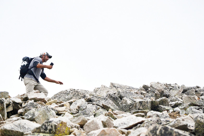 Dallas Weaver, of Denver, hikes toward the peak of Mount Huron on July 15. Weaver, who moved from Arkansas to Colorado to climb mountains, hopes to complete all fourteener summits by the end of 2020.