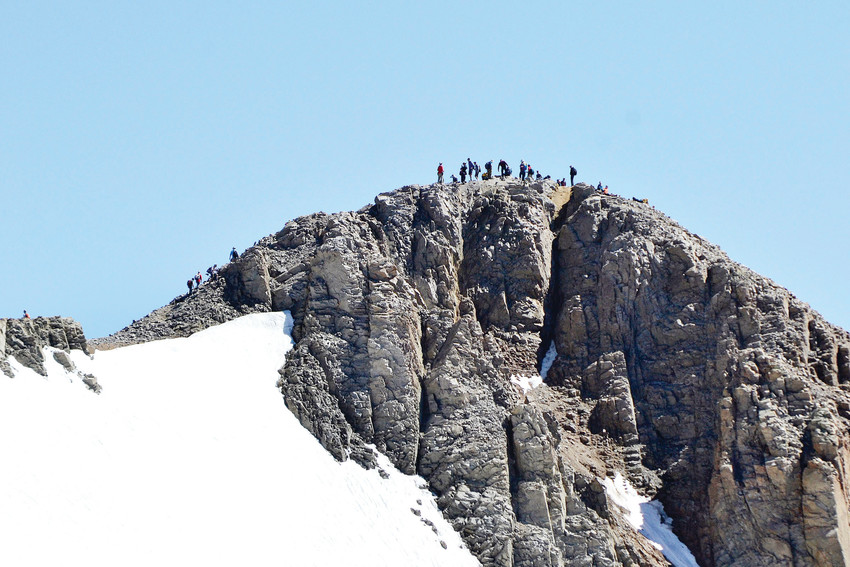 People crowd the Mount Lincoln summit in July.