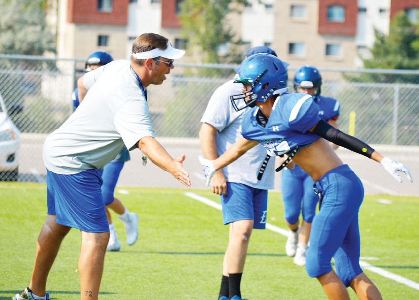 "New Englewood head coach Mike Campbell, who moved from his coaching position at Arapahoe, had 45 players come out for football this season at a program that hasn't had a winning season in seven years. He had a group of 15 players who were regulars at a tough summer workout program and 10 others that were in attendance a majority of the time. ""They had never done that before and that was a tremendous culture shock for them,"" he said."