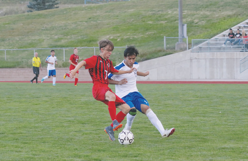 Alameda's Kevin Rodriquez, 2, battles for control of the ball with Elizabeth junior Caden Farmer, 7, during the Aug. 22 non-league soccer game. Rodriquez eventually got control of the ball and helped push the Pirate attack as Alameda won the game, 3-0.