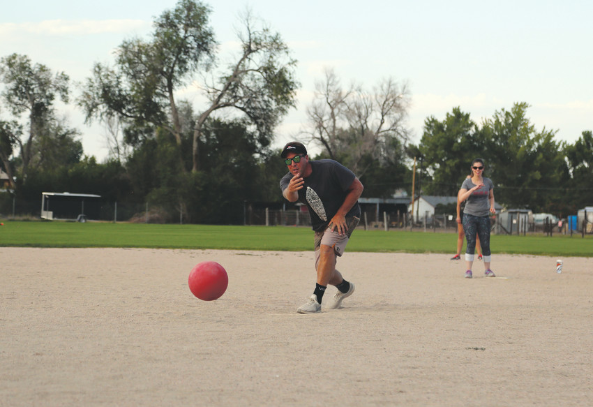 Chuck Norris pitches for the Seasoned Professionals in their kickball game against Arvada Young Professionals.