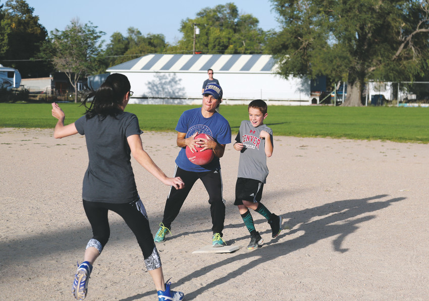 Katie Winner makes an out at first base for the Seasoned Professionals team at the Aug. 29 kickball game.