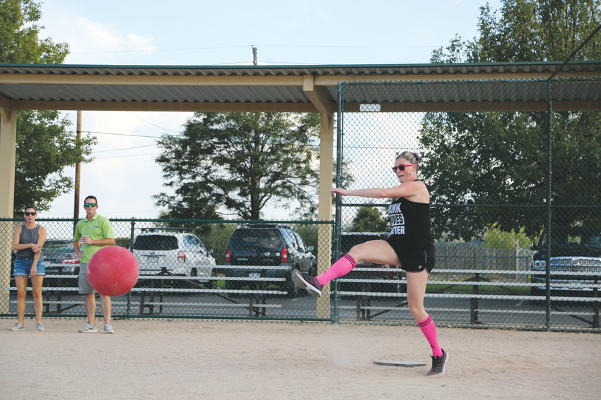 Andrea Romero kicks for the Seasoned Professionals team at the Aug. 29 Chamber kickball game.