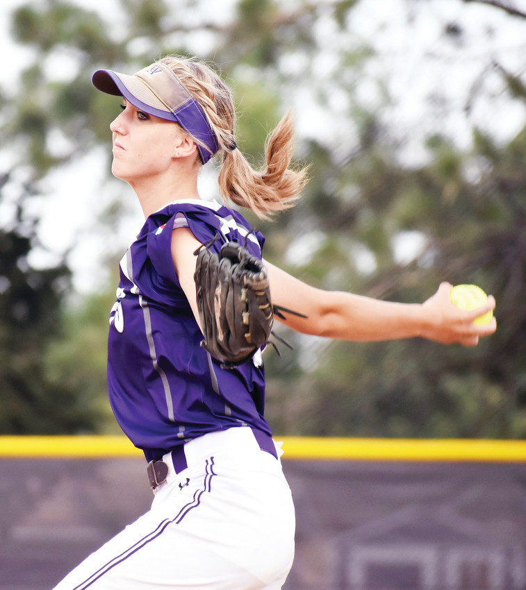 Arvada West sophomore pitcher Savannah Clausen fires a pitch during the Wildcats' 15-7 home victory over Golden on Aug. 28. Clausen pitched four scoreless innings in relief.