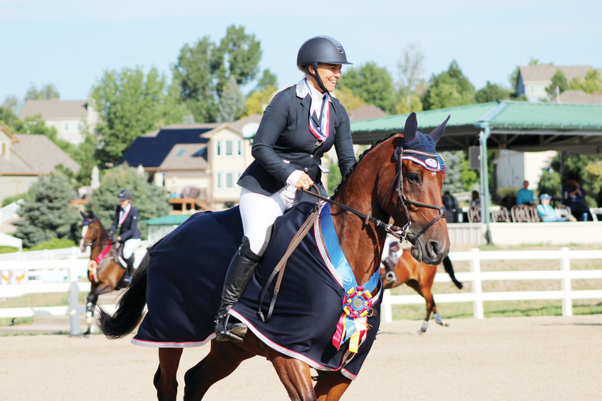 Heather Morris, riding Charlie Tango, takes her victory lap after being crowned the first-place winner of the intermediate division at the American Eventing Championship at the Colorado Horse Park Sept. 2.