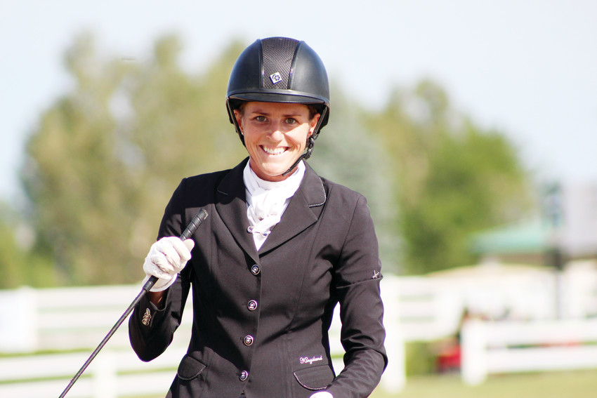 Alexa Ehlers of Kentucky, riding Amistoso, smiles as she finishes her final round of show-jumping at the American Eventing Championship at the Colorado Horse Park Sept. 2. The event was hosted by the United States Eventing Association and is the highest level of competition for the sport of eventing in the county.