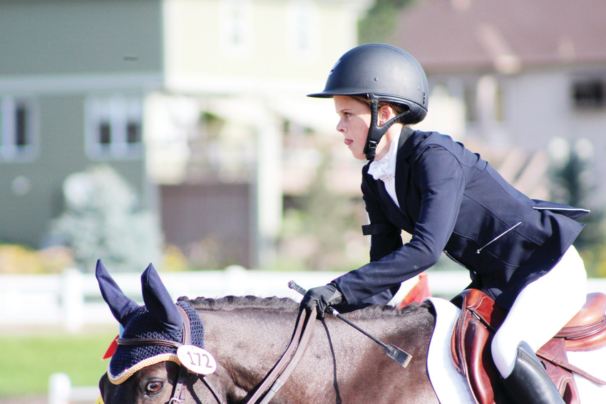 Hailey Weber of California, riding Master Jockey, clears an oxer during her final run in the show-jumping leg of the American Eventing Championship's junior novice division. Weber finished seventh with a score of 34.3.