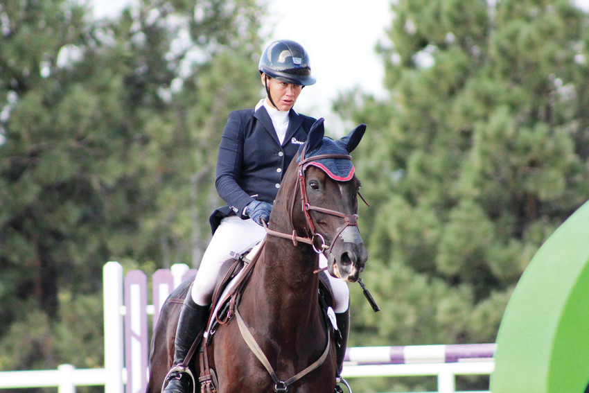 Tamra Smith prepares to clear the final oxer of her championship round in the American Eventing Championship at the Colorado Horse Park Sept. 2. Smith's finish in the final leg, show-jumping, helped her clinch first in the AEC and $20,000 in prize money.