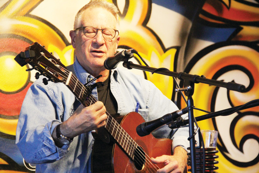 Steve Smulian, 71, performs Aug. 28 at the open-mic night at 38 State Brewing Company at 8071 S. Broadway in Littleton. A musician for decades, Smulian said he's made lasting friendships from open-mic nights.