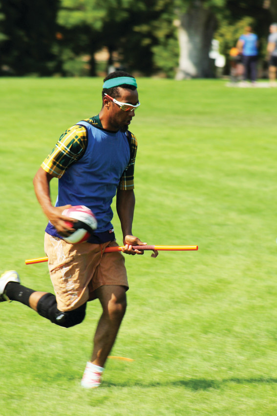 Denver native Devaughn Gamlin runs across the field at Cheesman Park during quidditch practice. Gamlin first started playing seven years ago while attending college at the University of Northern Colorado.