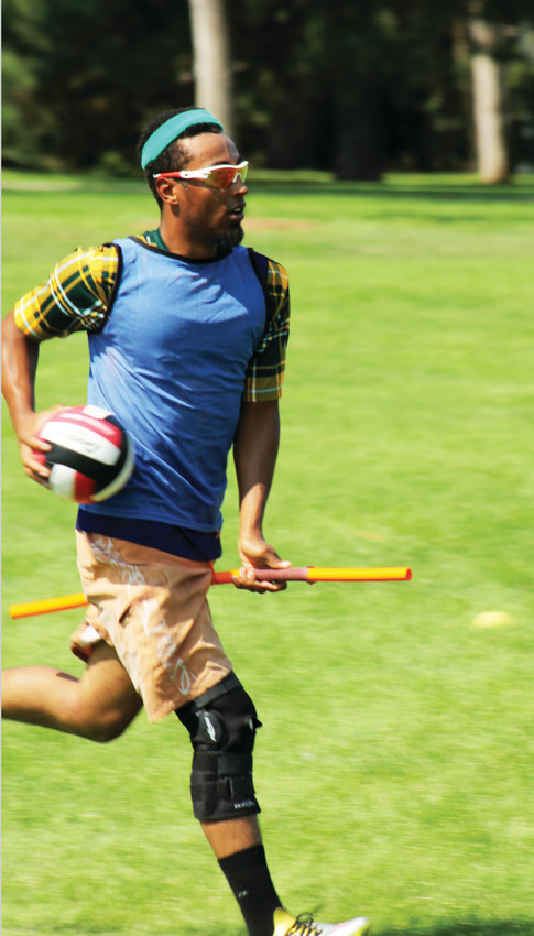 Devaughn Gamlin runs with a quaffle during a quidditch scrimmage at Cheesman Park. Gamlin said his dream is to eventually play in a World Cup event.