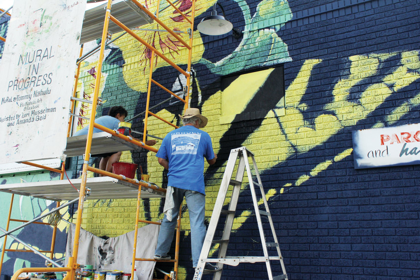 Tommy Nahulu, a mural artist based in Denver, painted a new butterfly mural on Sixth Avenue in Capitol Hill in May. He painted his first mural as a student at East High School.