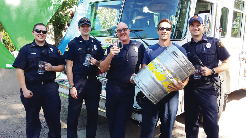 A group of Golden's firefighters stand together during a previous year's GoldenFest holding Golden City Brewery's limited edition GoldenFest mugs. GoldenFest is an annual fundraiser event for the Golden Fire Department which takes place on Sept. 8 this year.