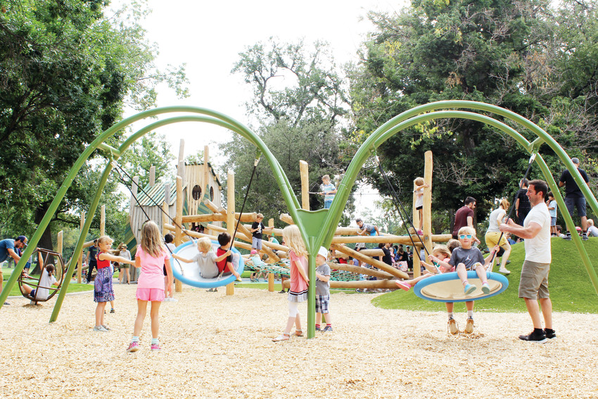 The new playground at Washington Park is made of repurposed wood and sits between the two lakes. The city will also be replacing the nearby basketball courts next spring.