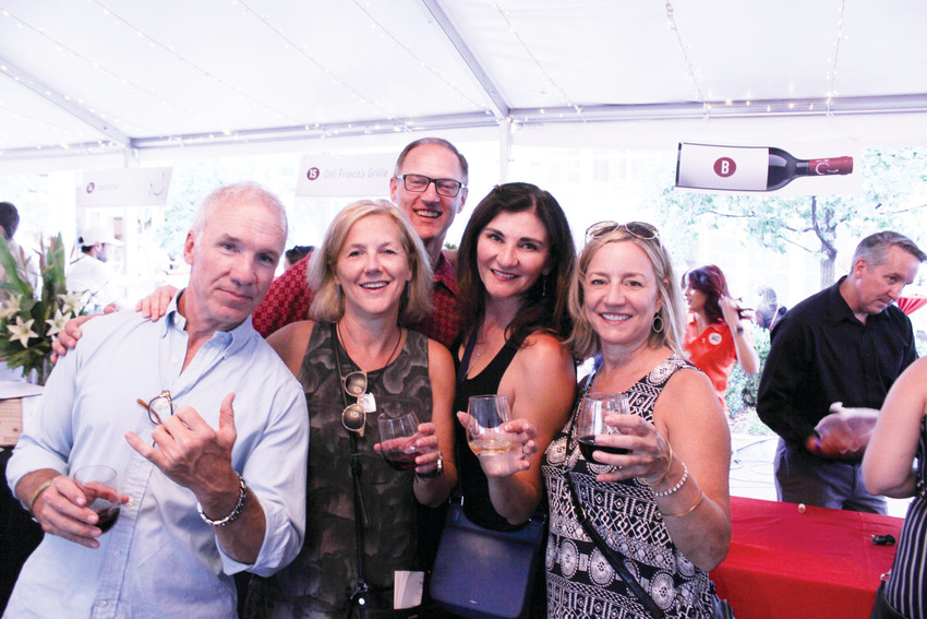 From left, Joe Taylor, Shelley Fletcher, Sandy Mathias, Jenine Mathias and Sue Barlow pose for a group picture at the Cherry Creek North Food and Wine event. The festival celebrates restaurants in the Cherry Creek North area and celebrated its 10th anniversary this year.