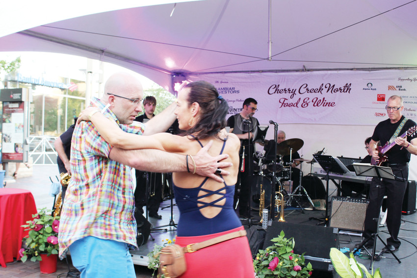 Phillip Wingfield, left, dances with his wife Patti Parkis at the Cheery Creek North Food and Wine event. The pair went to the event to celebrate Wingfield's birthday.