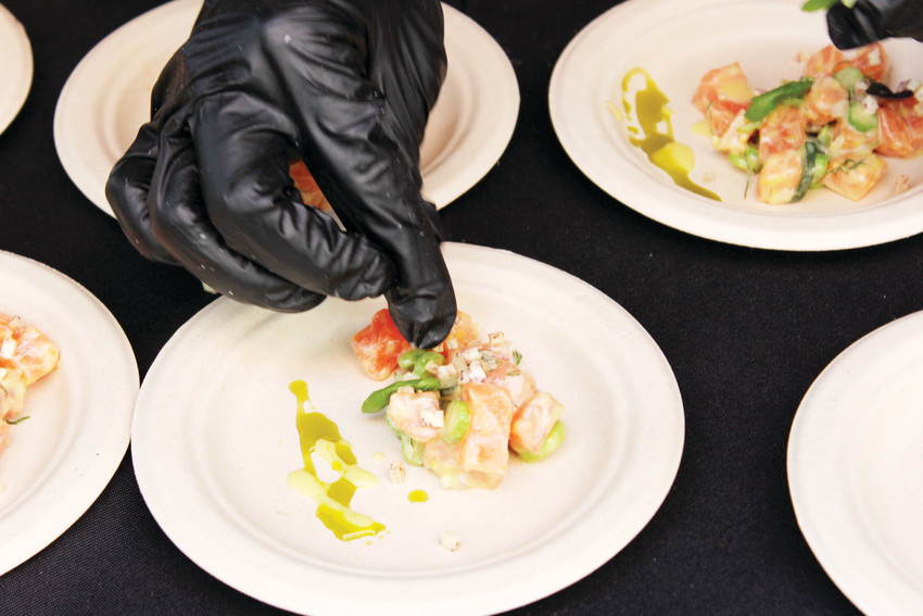 A cook with Departure Restaurant + Lounge puts the finishing touches on trout tartare at the Cherry Creek North Food and Wine. Departure won the Best in Show award at the event that night.