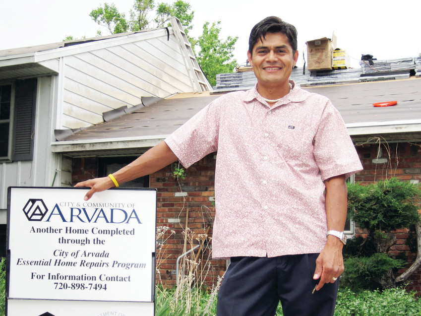 William Quintanilla, program specialist for Arvada Essential Home Repairs Program, stands in front of a house after repairs were completed.