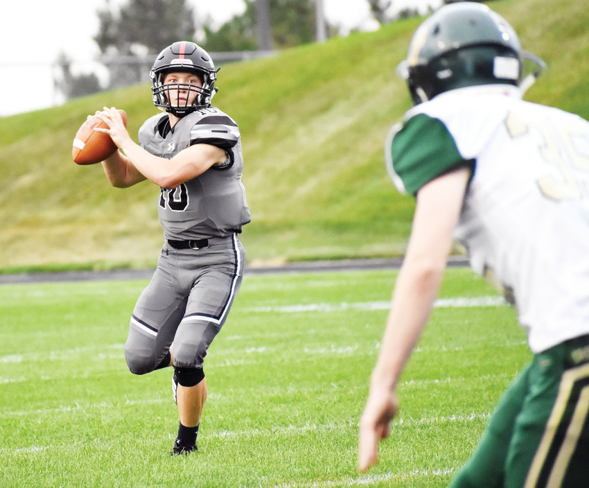Pomona senior quarterback Colten Muller (10) drops back to pass Aug. 30 at the North Area Athletic Complex during the non-league game against Bear Creek. Muller threw for three touchdowns and ran for another pair as Pomona blasted Bear Creek 49-6.