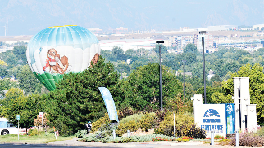 "The hot air balloon ""Hareship"" lifts off over the vacant lot just south of Front Range Community College's Westminster campus, part of the school's 50th anniversary celebration."