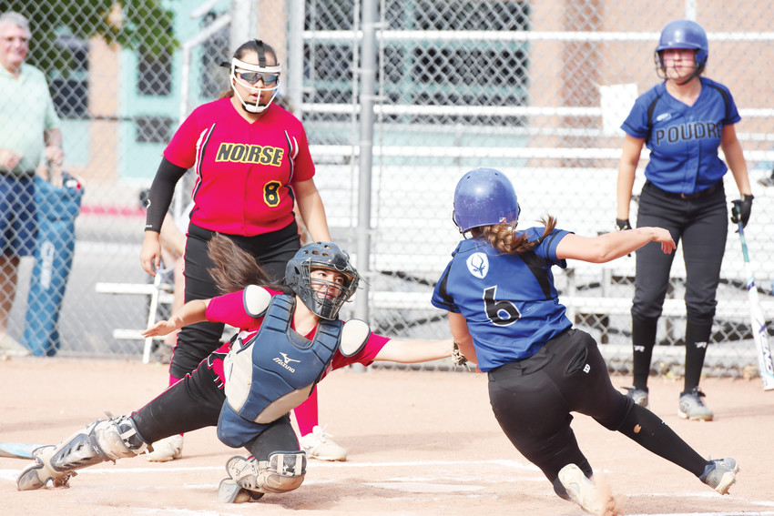 Northglenn senior catcher Leticia Delgado tags out Poudre's Ayla Rivera at the plate, during the first inning of a game Aug. 28 at Northglenn High School. The visiting Impalas easily handled the Lady Norse, 12-5.