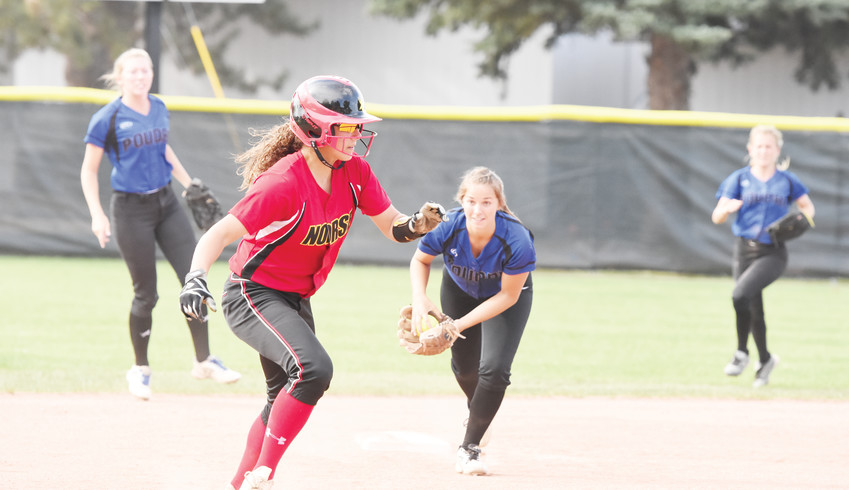 Northglenn baserunner Sidney Wilson, left, is chased toward third base in a rundown by Poudre infielder Jennasi Fall. Wilson would eventually reach third base, though the Norse were beaten by the Impalas, 12-5.
