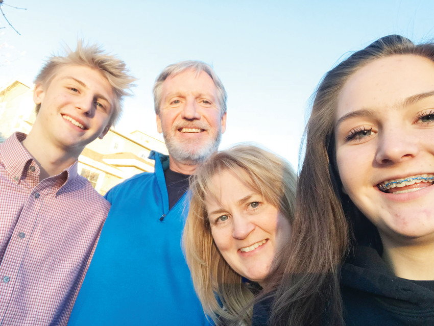 "The Rhoades family — from left, Jacob, his father and mother, Jim and Kendra, and sister Cienna — lives in Parker. Jacob is working to overcome a dependency on marijuana and has been clean since December. The family is proud of how far he's come. ""His whole attitude has changed,"" his mother said."