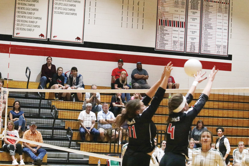 Cardinal teammates Ashley Gerczynski, 11, and Allison Borgsmiller, 4, join forces to block a D'Evelyn effort to drive the ball over the net during the Sept. 4 non-league volleyball game. The successful block helped earn Elizabeth a point but the Jaguars went on to win the match, 3-0.