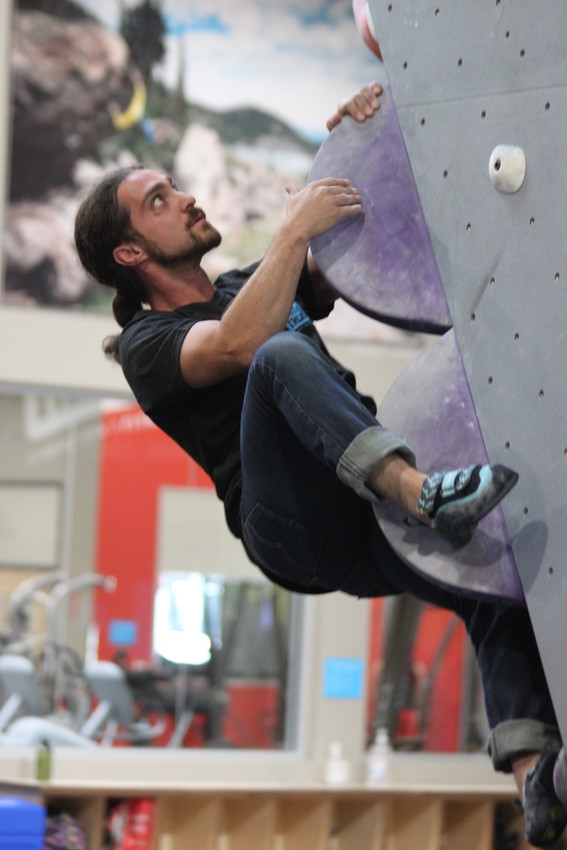 "Earth Treks climbing instructor Adam Avello makes his way up a bouldering route. ""Climbing is about facing your fears,"" Avello said. ""It's about pushing forward and focusing on your goal. It's analgous to life."""