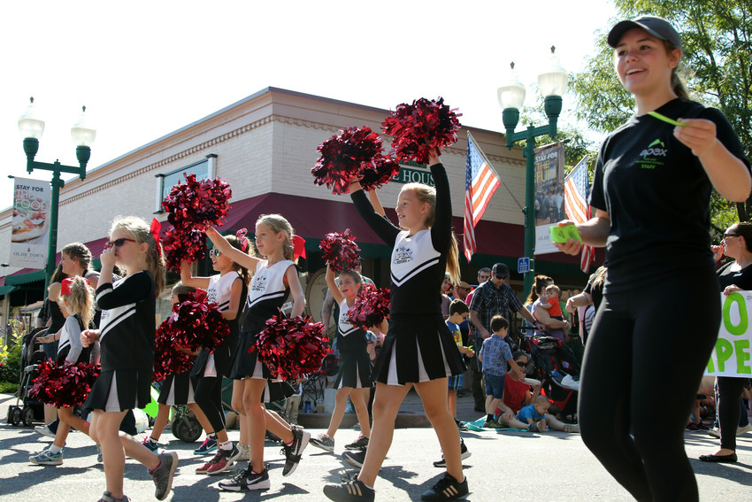 Apex cheerleaders kept the spirit high as they walked the 2018 Harvest Festival Parade.