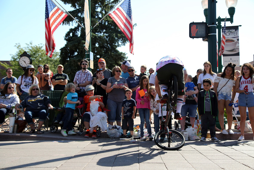 The crowd watches on as a BMX rider does a trick during the Harvest Festival Parade.