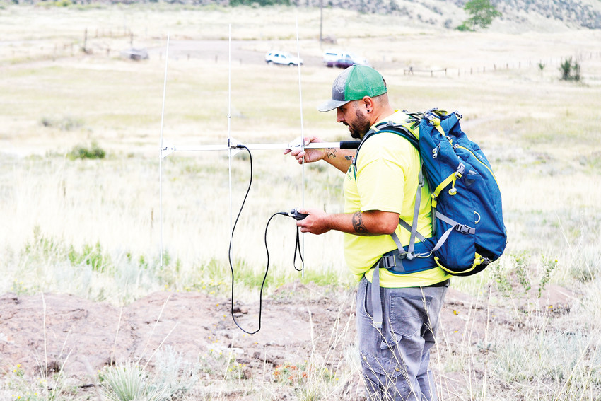 Ryan Borgmann of Adaptation Environmental Services uses an antenna and radio to track snakes on South Table Mountain in Golden on Thursday, Aug. 16. He is part of a research team capturing, implanting a radio transmitter and releasing snakes back on the mountain. The snakes are released at the exact place where they're found.