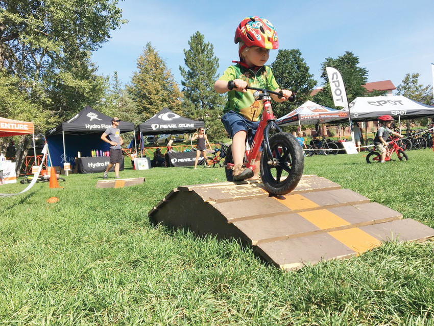Van Rice rides a kids' bike course at last year's Golden Giddyup mountain bike race and expo. This year, the expo will feature vendors, food trucks, a beer garden, live music and family-friendly activities. It takes place on Sept. 16 at Lions Park, 1300 10th St., in Golden.