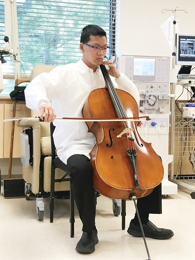 "Paul Trainor, 17, plays the cello at the DaVita Kidney Care dialysis center in Parker Sept. 5 for a dozen dialysis patients. The ""DaVita Day of Music"" consisted of 29 mini-concerts across the metro area for dialysis patients."