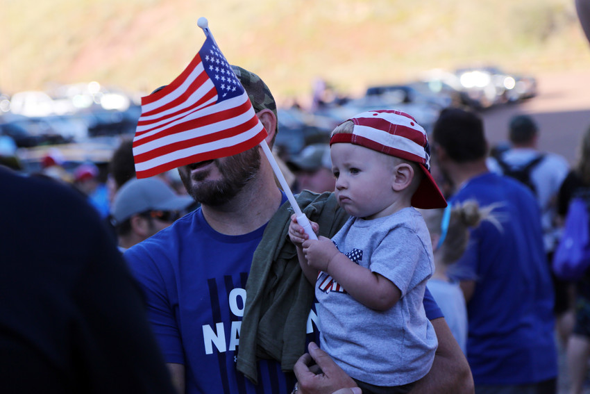 Benjiman Martinez waves the American Flag as his father, Ben Martinez, of Castle Rock, prepared to participate in the 10th annual 9/11 Star Climb at Red Rocks.